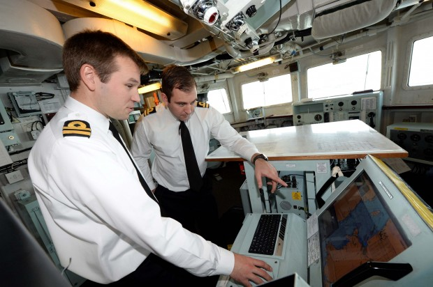 Lieutenant Costley-White (left) uses the electronic charts with Lieutenant McKenna HMS Kent © Royal Navy